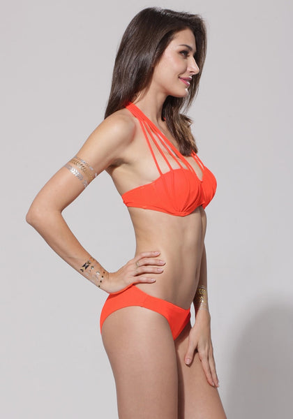Side view of model in strappy halter bikini