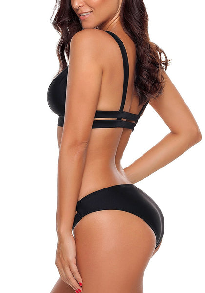 Side view of model in super sexy black strappy triangle bikini set