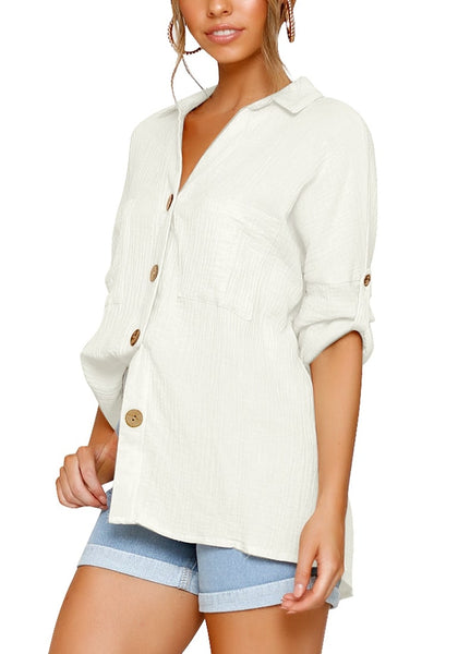 Side view of model in white collared V-neckline cuffed sleeves button-up top