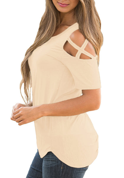 Side view of model wearing apricot crisscross cutout shoulder blouse