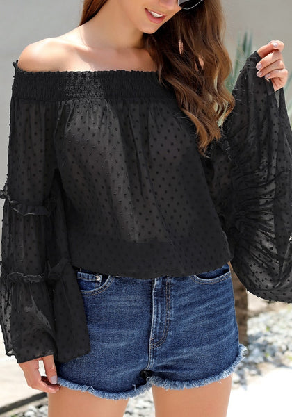 Side view of model wearing black bell sleeves dotted loose off-shoulder top