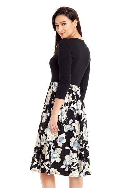 Side view of model wearing black floral-bottom V neckline crop sleeves skater dress