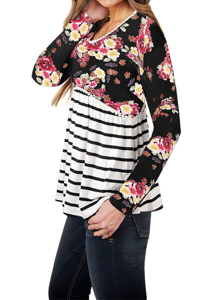 Side view of model wearing black floral striped empire-cut top