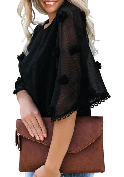 Side view of model wearing black mesh floral bell sleeves lace trim loose top