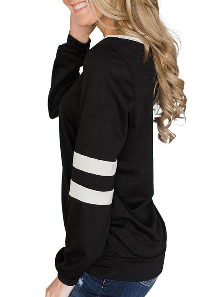 Side view of model wearing black round neckline striped long sleeve sweatshirt
