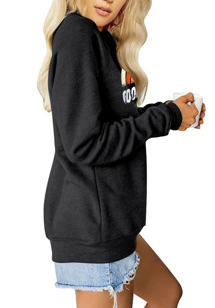 Side view of model wearing black statement print crewneck sweatshirt