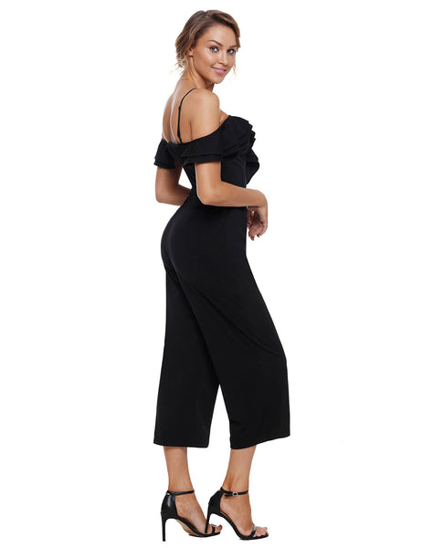 Side view of model wearing black sweetheart neckline cold-shoulder jumpsuit