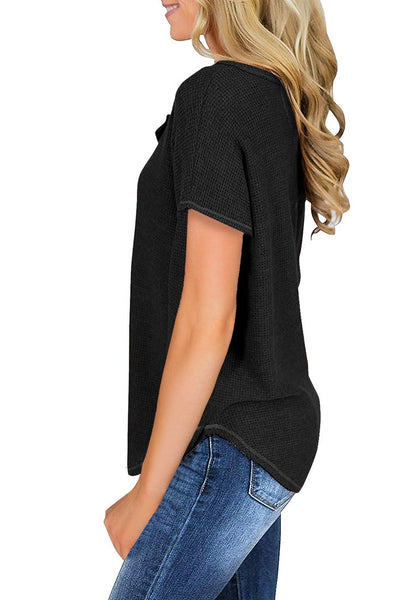 Side view of model wearing black waffle knit short sleeves henley top