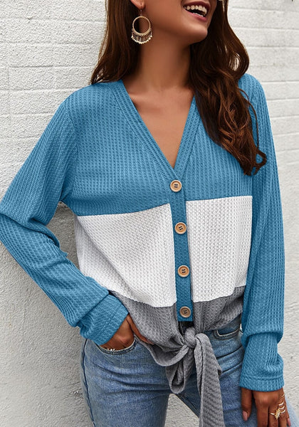 Side view of model wearing blue V-neckline button-up tie-front colorblock waffle knit top
