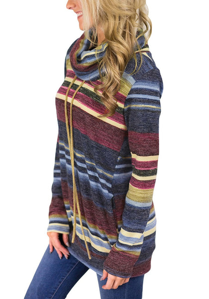 Side view of model wearing blue striped colorblock cowl neck drawstring pullover top
