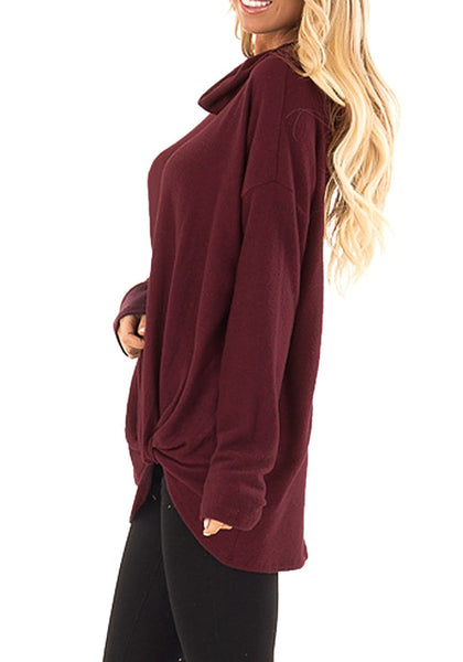 Side view of model wearing burgundy cowl neck side twist knot tunic top