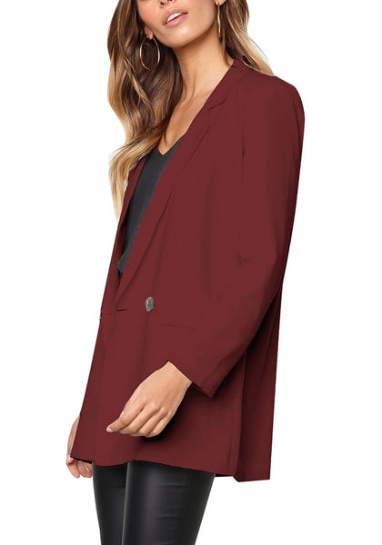 Side view of model wearing burgundy mock-pocket double-breasted lapel blazer