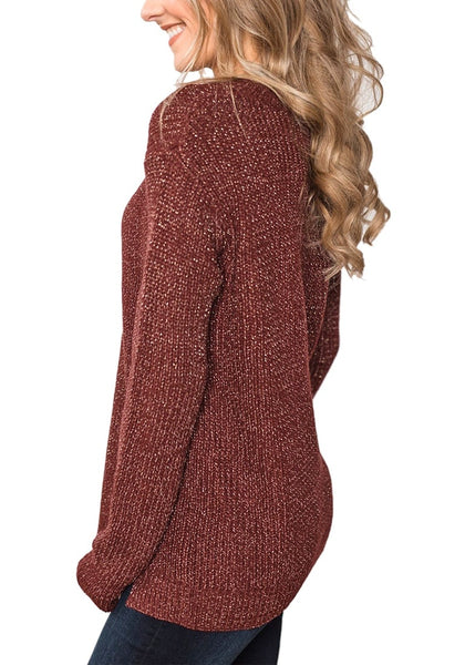 Side view of model wearing burgundy velvet knit side-slit pullover sweater