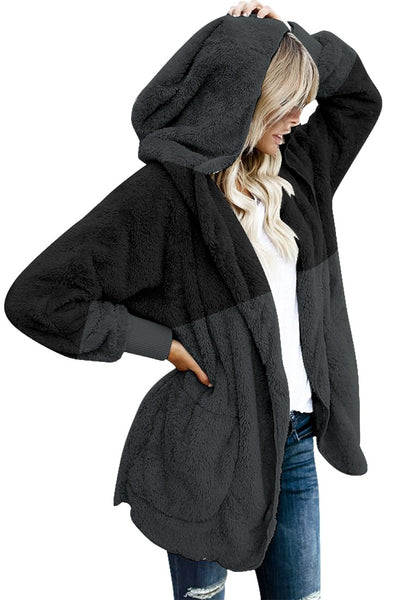 Side view of model wearing dark grey  color block hooded fleece cardigan