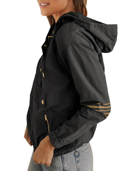 Side view of model wearing dark grey half-zip snap buttons hooded jacket