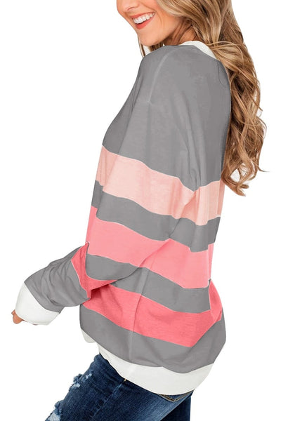 Side view of model wearing grey color block striped pullover sweatshirt