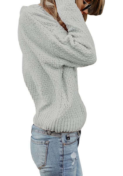 Side view of model wearing grey crew neck velvet cable knit pullover sweater