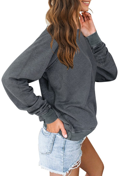 Side view of model wearing grey french terry crewneck pullover sweatshirt