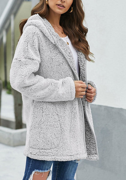 Side view of model wearing grey fuzzy fleece hooded open-front oversized coat