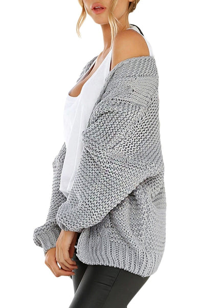 Side view of model wearing grey open-front chunky knit sweater cardigan