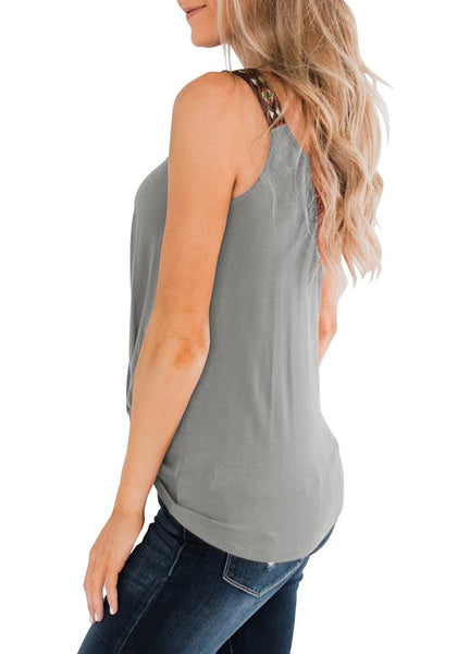 Side view of model wearing grey twist knot embroidered straps tank top