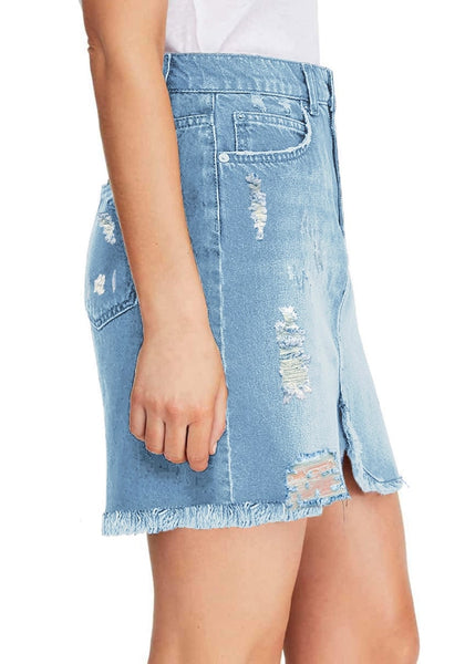 Side view of model wearing light blue frayed hem distressed mini denim skirt