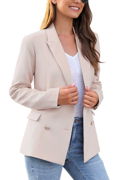 Side view of model wearing light mauve notch lapel double-breasted blazer