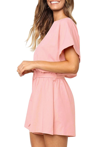 Side view of model wearing light pink elastic-waist short sleeves belted loose romper