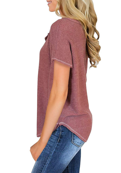 Side view of model wearing mauve pink waffle knit short sleeves henley top