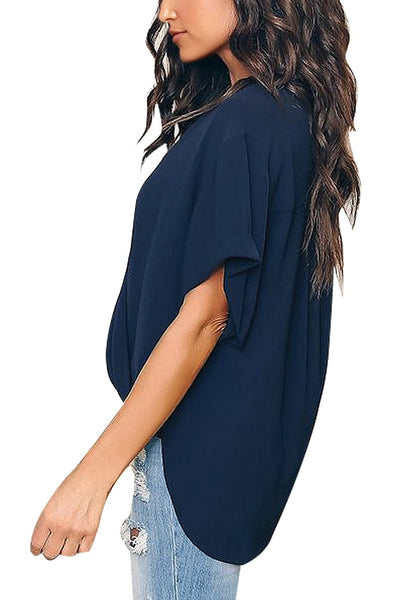 Side view of model wearing navy V-neckline cuffed sleeves loose wrap blouse