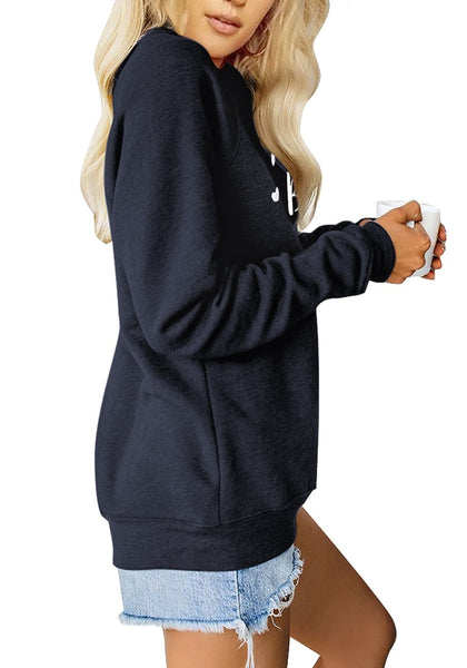 Side view of model wearing navy blue statement print crewneck sweatshirt
