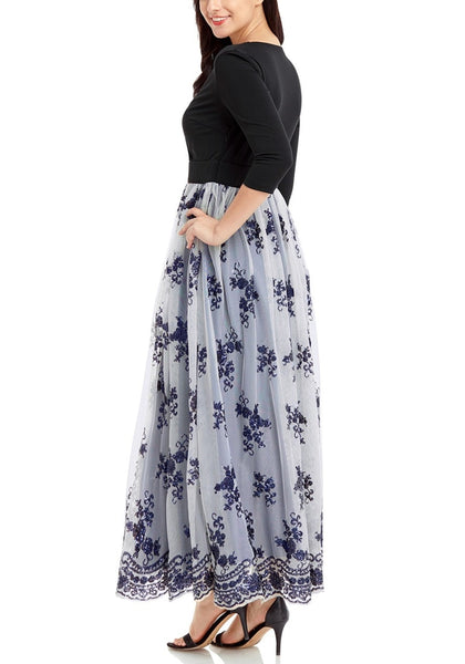 Side view of model wearing navy mesh floral sequin maxi dress