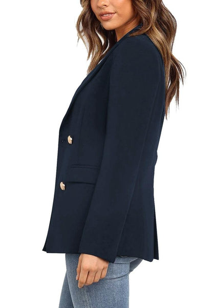Side view of model wearing navy  notch lapel double-breasted blazer