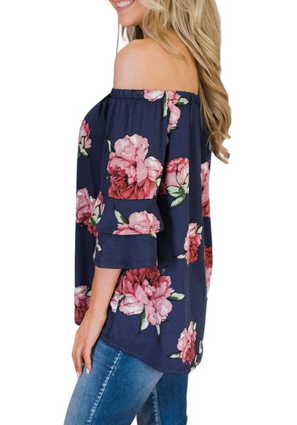 Side view of model wearing navy ruffle sleeves floral off-shoulder top