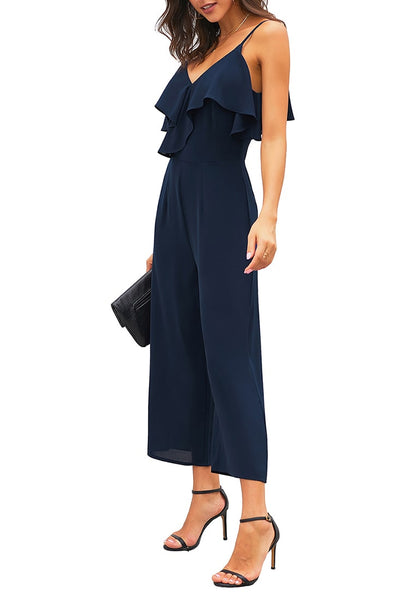 Side view of model wearing navy ruffled spaghetti-strap surplice jumpsuit's