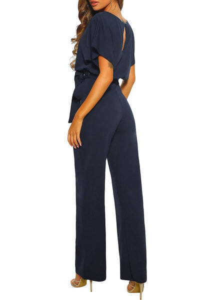 Side view of model wearing navy short sleeves keyhole-back belted jumpsuit