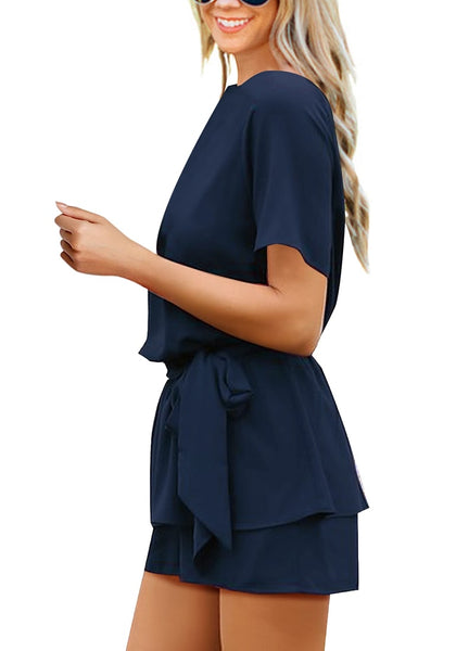 Side view of model wearing navy short sleeves keyhole-back belted romper