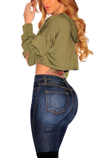 Side view of model wearing olive green ripped hoodie crop top