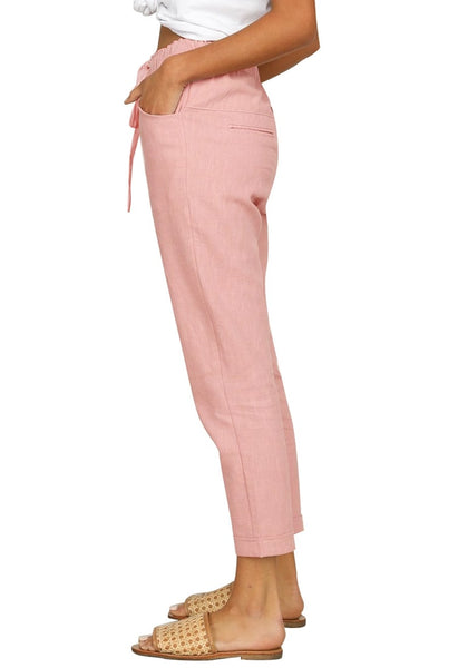 Side view of model wearing pink drawstring-waist rolled-up cropped pants