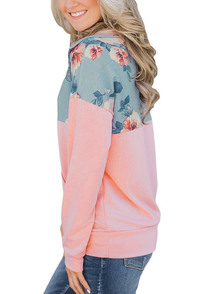 Side view of model wearing pink floral patchwork print half-zip pullover top