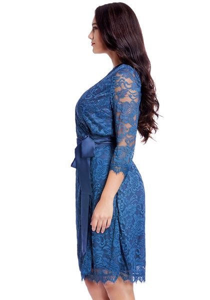 Side view of model wearing plus size blue lace crop sleeves wrap dress
