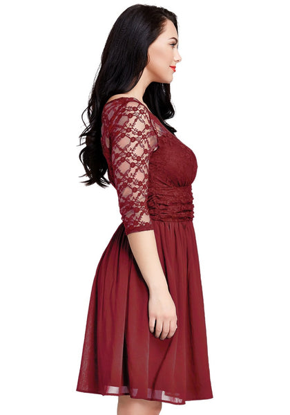 Side view of model wearing plus size burgundy lace crop-sleeves skater dress