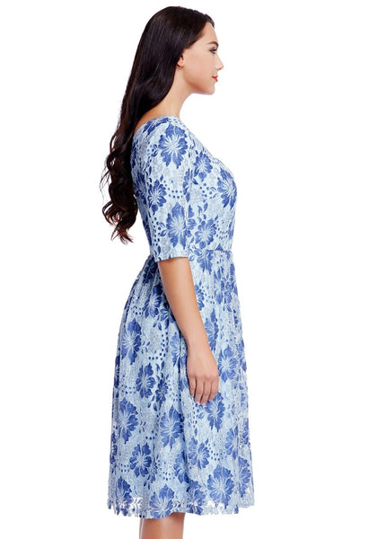 Side view of model wearing plus size light blue floral-print lace dress
