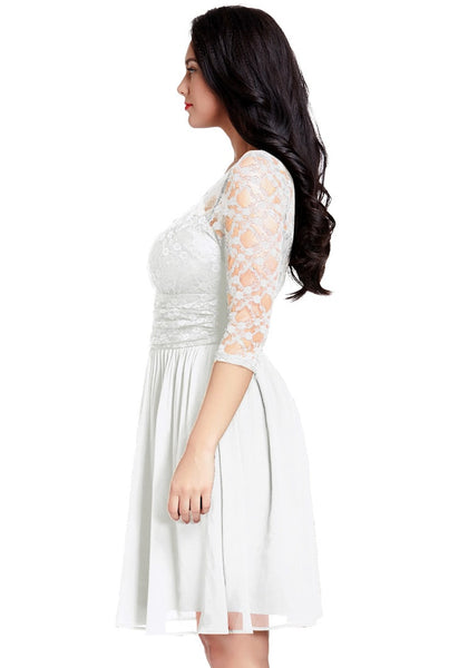 Side view of model wearing plus size white lace crop-sleeves skater dress