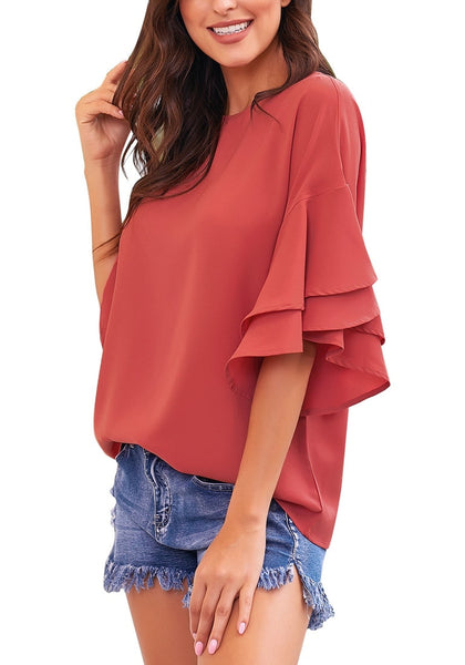 Side view of model wearing rust red trumpet sleeves keyhole-back blouse