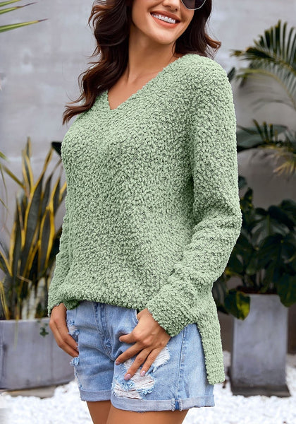 Side view of model wearing sage green V-neckline popcorn fuzzy fleece pullover sweater