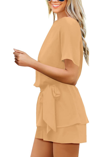 Side view of model wearing tan short sleeves keyhole-back belted romper
