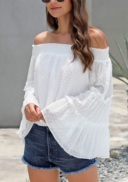 Side view of model wearing white bell sleeves dotted loose off-shoulder top
