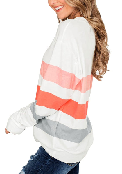 Side view of model wearing white color block striped pullover sweatshirt