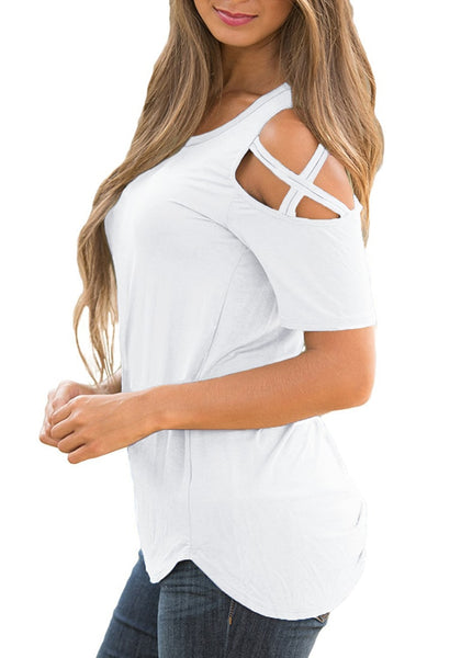 Side view of model wearing white cisscross cutout shoulder blouse